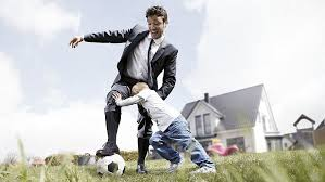 person playing soccer with a kid