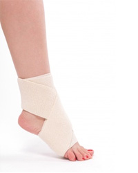 picture of a woman wearing white compression bandages on swollen feet