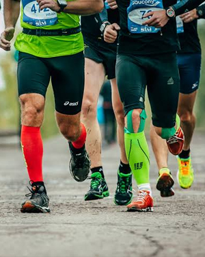 picture-of-athletes-running-on-road-wearing-compression-socks-sports-shoes