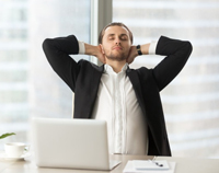 picture-of-man-relaxing-with-hands-behind-neck-sitting-on-chair-in-office