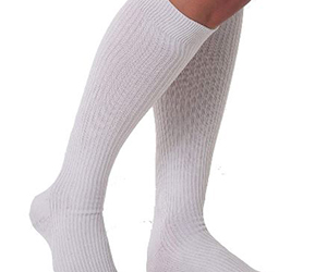 20-30 mmHg compression socks will help most for the swollen ankle