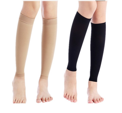20 - 30 mmhg multi color knee high compression socks wore by a pregnant woman