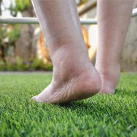 picture of man walking with puffy swollen feet on grass