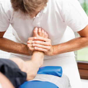 person treating swelled feet