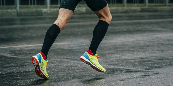 Men running in black compression socks