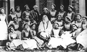 Picture of Florence Nightingale in middle with other nurses of her school, nurses in white in 19th Century