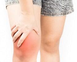 person holding pain-stricken knee