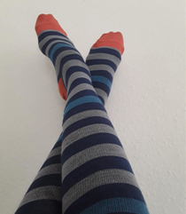 picture of a nurse sitting in hospital wearing a pair of multicolored compression socks