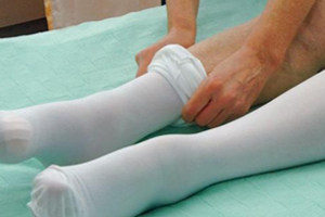 picture of a nurse wearing a pair of knee-high white compression socks