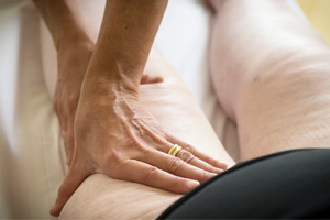 doctor treating person's swelled thighs