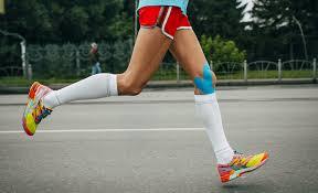 athlete running in proper sports attire