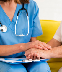 picture of nurse in blue uniform with stethoscope holding hands with old patient and consoling on graduated knee high clothing and how they help improve blood circulation