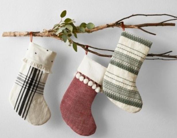 socks hanging on a tree branch