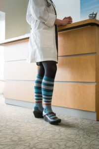 A nurse wearing compression hosiery