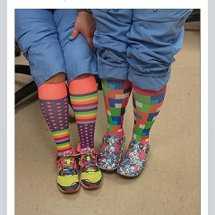 An image of two nurses wearing colorful compression hose