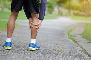 a man with leg injury after exercise