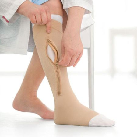A patient wearing zip-up pressure socks with ease