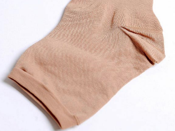 Close up shot of nude color compression stocking