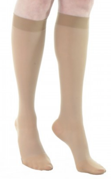 Compression knee high stockings with silicone border