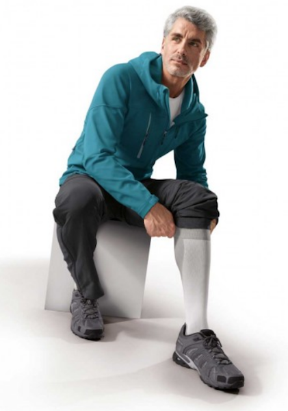 man wearing a pair of gray men's compressions socks/support socks of 20-30 mmHg