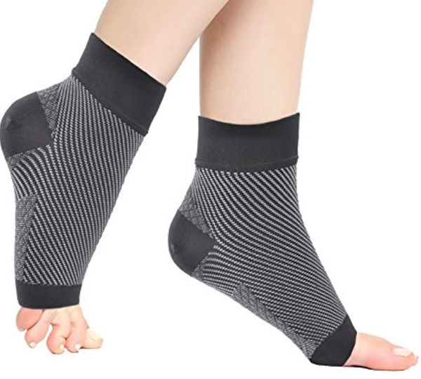 A pair of compression ankle socks and stockings include arch/heel support and accelerated blood flow to reduce pain and soreness in the feet