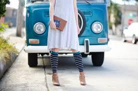 A person is wearing classy strips socks.