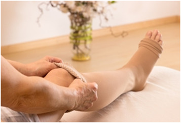 Women wearing 15 - 20 mmHg knee high compression socks and stockings