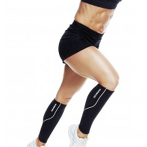 a female athlete wearing support socks help boost blood flow to heal injury to the calf and knee
