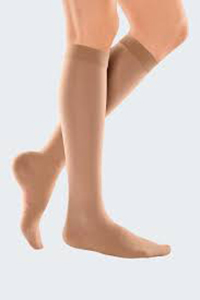 a woman wearing knee high 20 - 30 mmHg support womens compression socks
