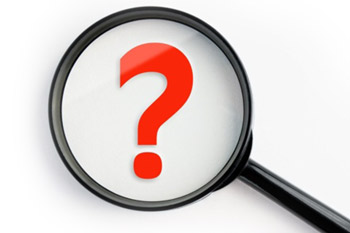 A magnifying glass with a question mark in the center