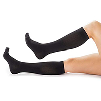 alleviate swollen legs with support hosiery