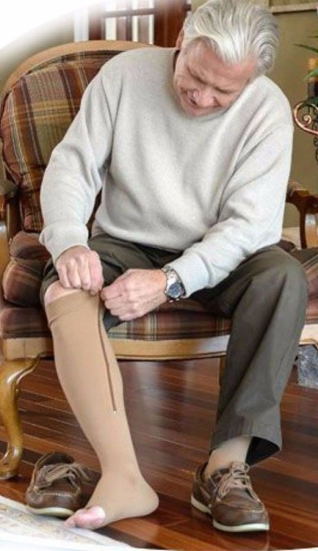Image showing an old man wearing zippered compression socks