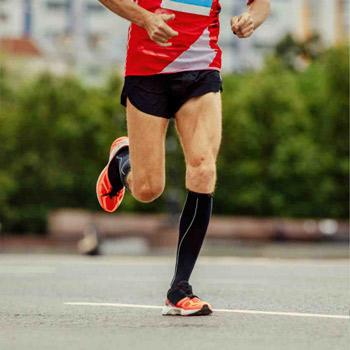 Man runnning wearing compression socks