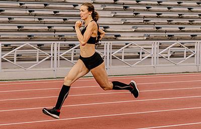 Woman wearing compression socks running