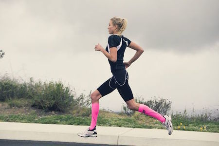 Athlete using compression socks during a run to prevent shin splints