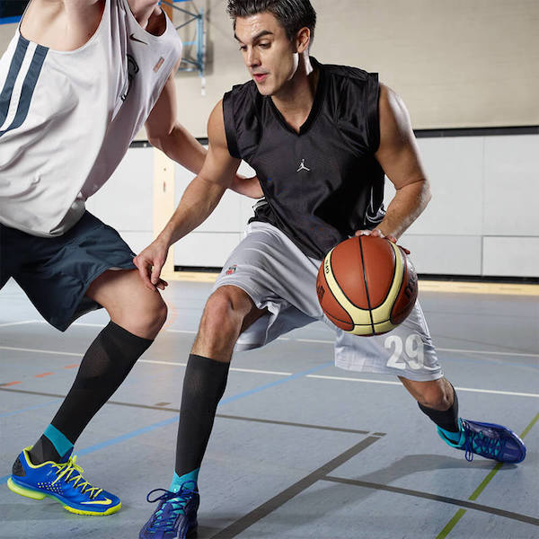 Basketball player wearing black compression socks