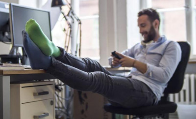 Man wearing compression socks for men while sitting