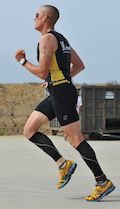 Man running while wearing compression leg sleeves