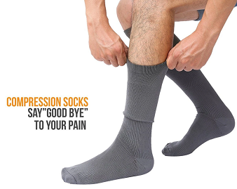 person putting on knee high compression socks