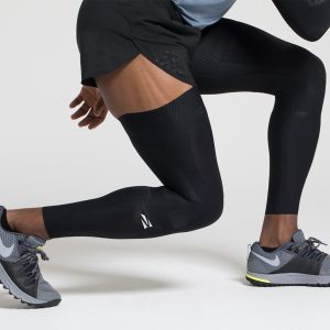 a male person working out and enjoying the benefits of using a compression sleeve
