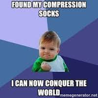 Baby holding his hand in a fist saying Found My Compression Socks, Now I can Conquer The World