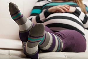 A pregnant woman in compression gear but not zippered compression socks
