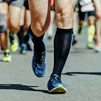 athletes wearing running compression socks