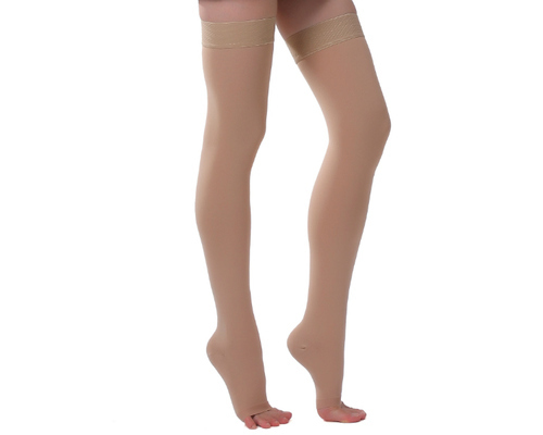 Image of woman wearing open toe cotton compression stocks