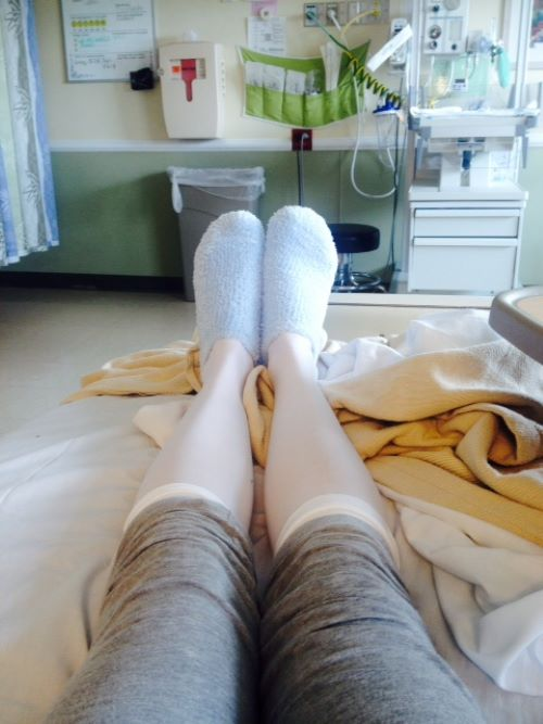 woman wearing compression socks in a hospital bed