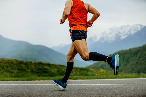 Man running, exercising with the best compression socks for edema