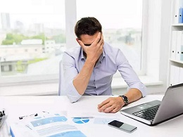 a person is depressed due to work load.