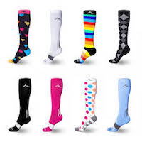 Several more compression socks designs. Colored hearts on a black stocking, plain white stocking with a single grey stripe, multicolored rainbow stripes, black and white tux design, black and pink stockings each with a white s tripe, a white stocking with bright pink , blue and orange spots, and lastly a light blue stocking with a grey stripe.