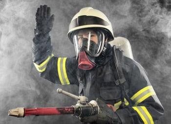 Firefighter in protective firefighting hazard equipment