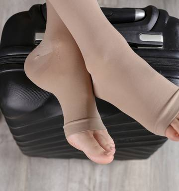 Toeless flight socks worn by traveller  or tourist cross legs on luggage